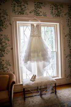 Mermaid trumpet wedding dress hanging in the Warrenwood Manor Bridal Suite