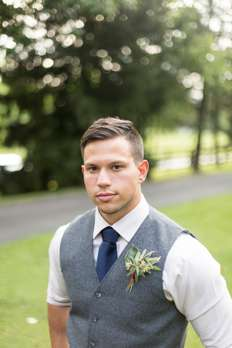 Dapper groom in gray and navy