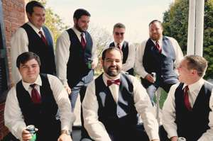 Groom and groomsmen in navy suits for fall wedding