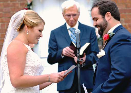 Bride and Groom exchange vows during fall outdoor ceremony