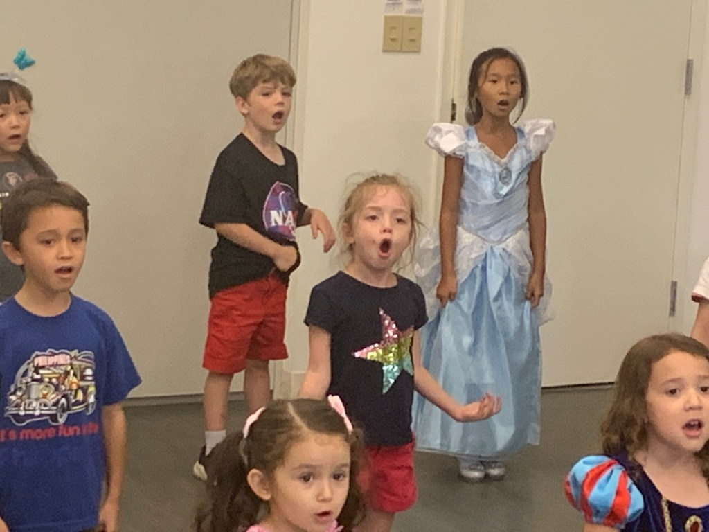 students singing in class