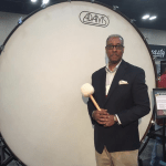 Greg Holloway standing in front of an extra large bass drum