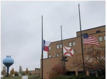 U.S. flag flying at half staff in West Bend