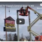 Signage being lifted into place at Casey's General Store