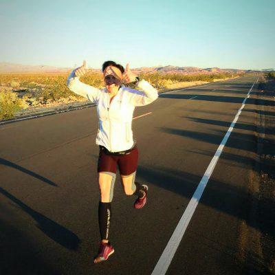 Thabetha Wolfe running in desert