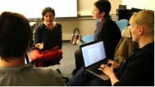 Science Trak's Norma Straw consults with Comm Lead students Katya Yefimova, Sarah McCaffrey &  John Hellriegel