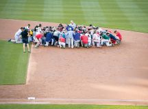 The next day, the game went on as planned, with players praying before the first pitch. Photograph Alex Wong/Getty Images.