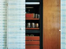 A built-in bar cabinet in a Capitol Hill space. Photograph by Constance Mariena.