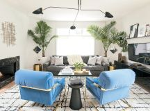 The pair of vintage blue chairs, also by Baughman, are another eBay find. The leather Restoration Hardware sofa came from Craigslist.