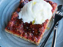 Pluma by Bluebird's tomato pizza topped with burrata.