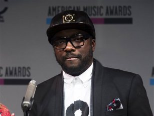 In this Oct. 10, 2013 file photo, Will.i.am announces the nominees for the American Music Awards, on Thursday, Oct. 10, 2013 in New York. (Photo by Charles Sykes/Invision/AP, File)