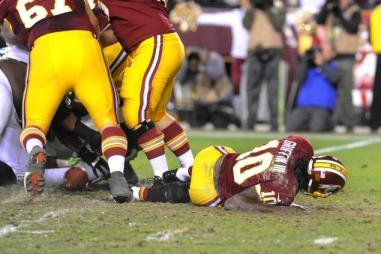 On Jan. 6, 2012, Robert Griffin III goes down with his season-ending injury against Seattle. (Richard Lipski/AP)