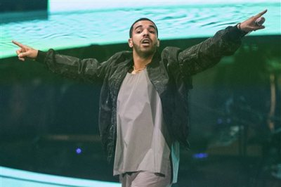 "In this Oct. 24, 2013 file photo, Drake performs during his ""Would You Like A Tour"" show in Toronto. The Toronto-based rapper, singer and actor will host the July 16, 2014, ESPYs sports awards show on ESPN in Los Angeles. (AP Photo/The Canadian Press, Chris Young, file)"