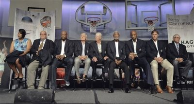 The 2014 class of inductees into the Basketball Hall of Fame, from the left, Jataun Nathaniel, accepting on behalf of her father Nat Clifton, Tony Rodgers, accepting on behalf of his father Guy Rodgers, Mitch Richmond, Gary Williams, Bob Leonard, Nolan Richardson, Alonzo Mourning, Sarunas Marciulionis, and David Stern sit together during a news conference at the Naismith Memorial Basketball Hall of Fame, Thursday, Aug. 7, 2014, in Springfield, Mass. (AP Photo/Jessica Hill)