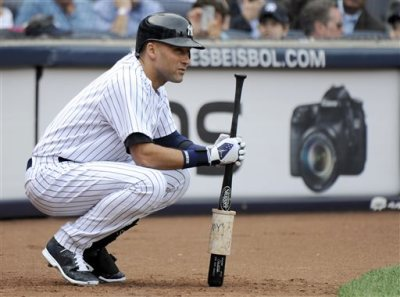 New York Yankees' Derek Jeter waits to bat during the fifth inning of a baseball game against the Baltimore Orioles Wednesday, Sept. 24, 2014, at Yankee Stadium in New York. (AP Photo/Bill Kostroun)