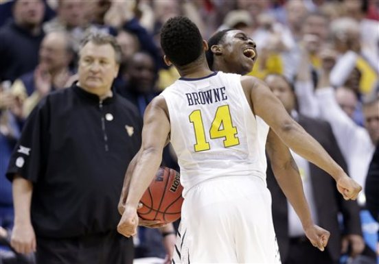 West Virginia's Juwan Staten, right, celebrates with Gary Browne (14) after a 68-62 win over Buffalo in an NCAA college tournament basketball game in the Round of 64 in Columbus, Ohio, Friday, March 20, 2015. (AP Photo/Tony Dejak)