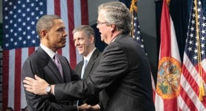 President Obama and JEb Bush shake hands, with Arne Duncan in the background, in 2011. (The Associated Press)