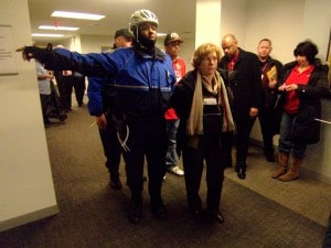 Weingarten being led away by police. (By  Bill Hangley Jr.)