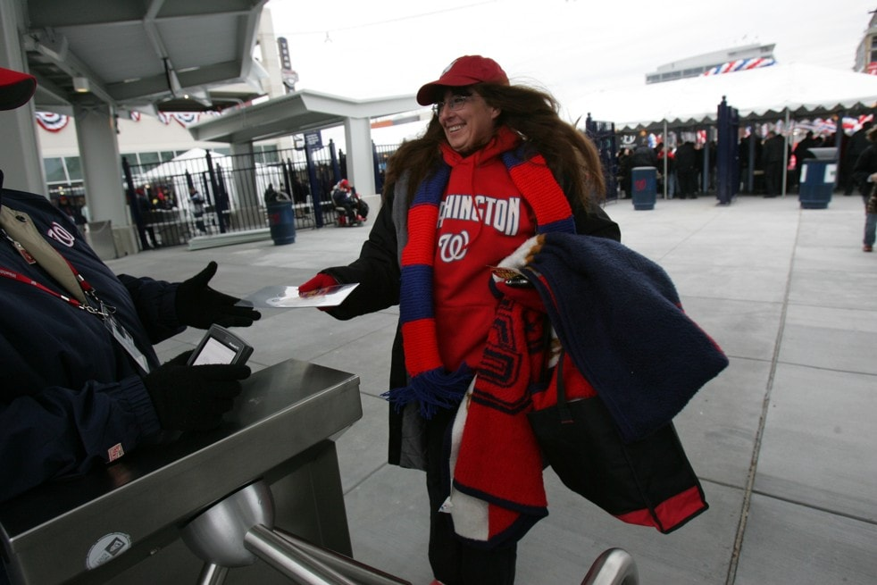 Caption: SLUG: sp_nats31 DATE: March 30, 2008 CREDIT: Jonathan Newton / TWP. EDITOR:remote LOCATION: Washington, D.C. SUBJECT: Nationals vs Atlanta Braves First game at NationalsPark. CAPTION: Season ticket holder Colleen Sherman of Arlington, VA is the first person through the gates at the new Nationals Stadium on opening day. She says she's been to every home game. StaffPhoto imported to Merlin on Sun Mar 30 16:56:01 2008