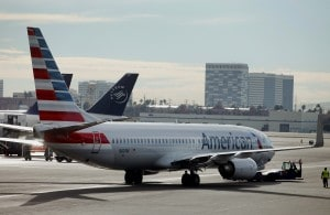 The price of a typical round-trip airline ticket will increase $6.20. (Patrick T. Fallon/Bloomberg)