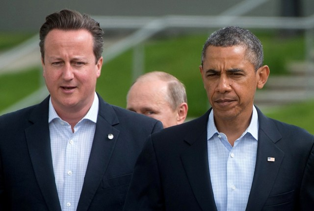President Obama and U.K. Prime Minister David Cameron at the June 2013 G8 summit, trailed by Russian president Vladimir Putin. (BERTRAND LANGLOIS/AFP/Getty Images)