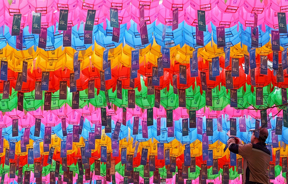 A worker attaches the name tag of a Buddhist who made donation to a lantern for upcoming celebration of Buddha's birthday on May 6 at the Jogye temple in Seoul, South Korea, Thursday, April 3, 2014. (AP Photo/Ahn Young-joon)