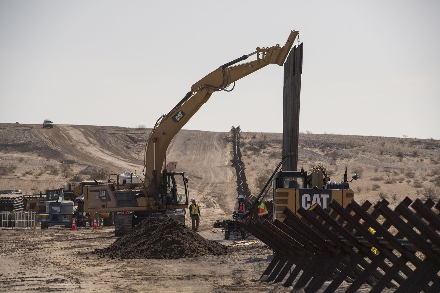 Construction in August along the U.S. border with Mexico, where the new border barrier will replace old fencing in Calexico, Calif. (Carolyn Van Houten/The Washington Post)