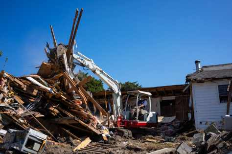 The home of Edward and Stella O'Neal is torn down due to damage caused by flooding during Hurricane Dorian in Ocracoke. (Daniel Pullen/for The Washington Post)
