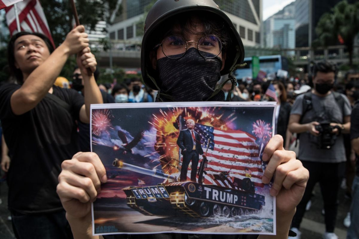 Protesters hold American flags and photos of President Trump on Sept. 8 in Hong Kong.  (Chris McGrath/Getty Images)