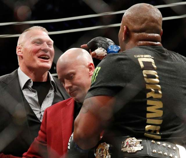 Brock Lesnar Left Taunts Daniel Cormier After Cormier Defeated Stipe Miocic At Ufc 226 John Locher Associated Press