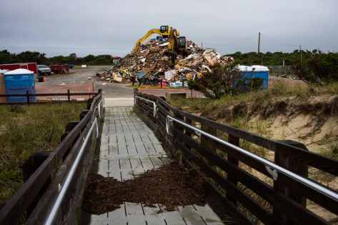 A pile of debris grows in Ocracoke. (Daniel Pullen/for The Washington Post)