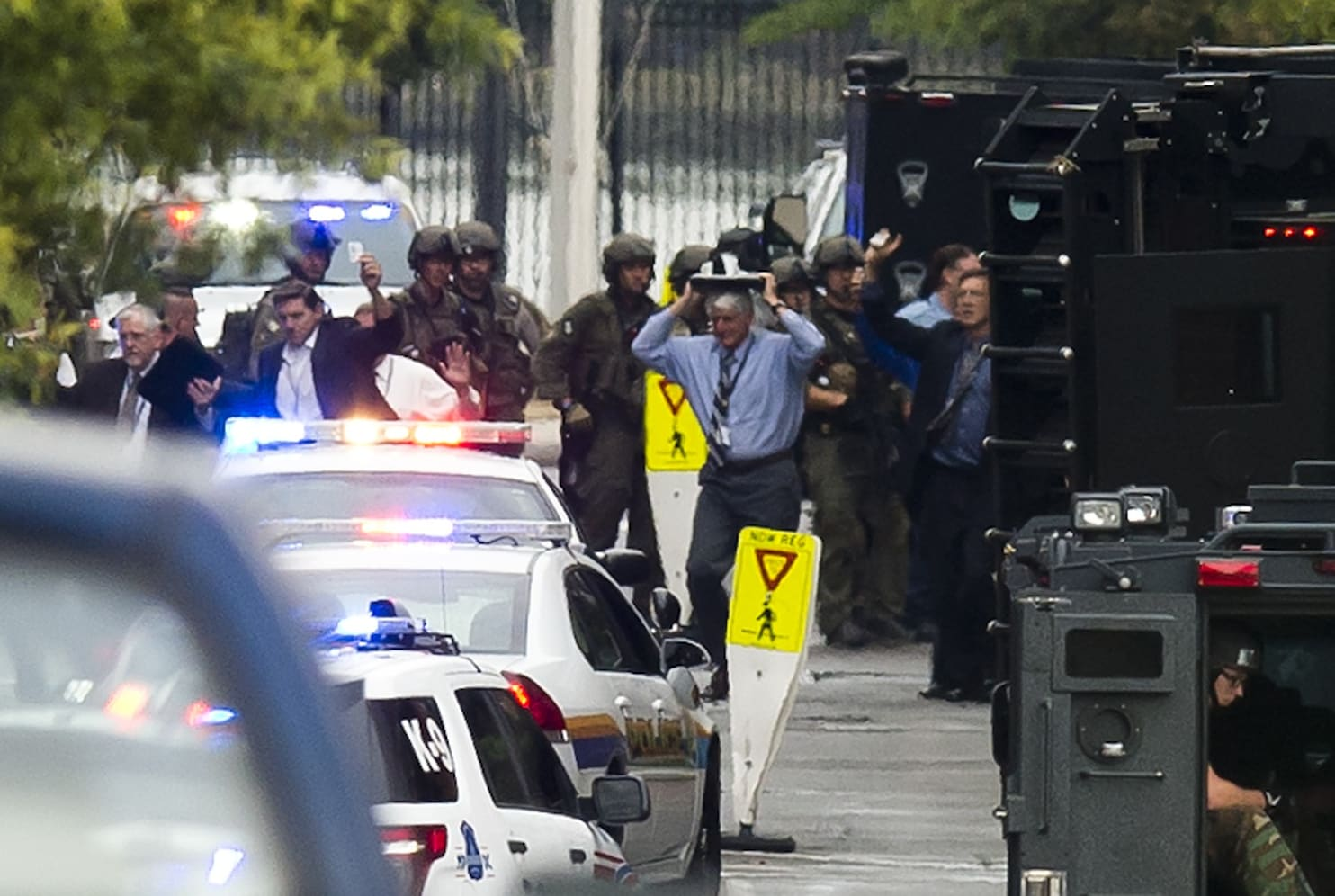 At least 13 dead in Navy Yard shooting possible suspect