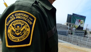 A US Border Patrol agent stands near a crossing to Mexico at the San Ysidro port of entry. (Frederic J. Brown/AFP-Getty Images).