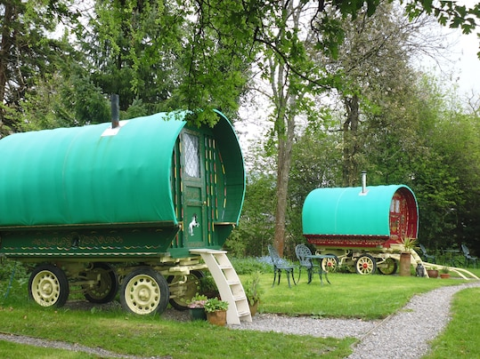 (Cat Kilgour/ ) - Restored traditional gympsy caravans dubbed Holly, left, and Rowan offer an escape in bucolic Bramble Bield, near Stirling, Scotland.