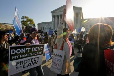 Click this image of protestors in front of the US Supreme Court to read coverage in The Washington Post.