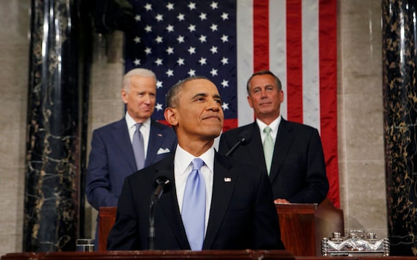 U.S. President Barack Obama smiles as he arrives to deliver his State of the Union speech on Capitol Hill in Washington January 28, 2014. REUTERS/Larry Downing (UNITED STATES - Tags: POLITICS TPX IMAGES OF THE DAY)