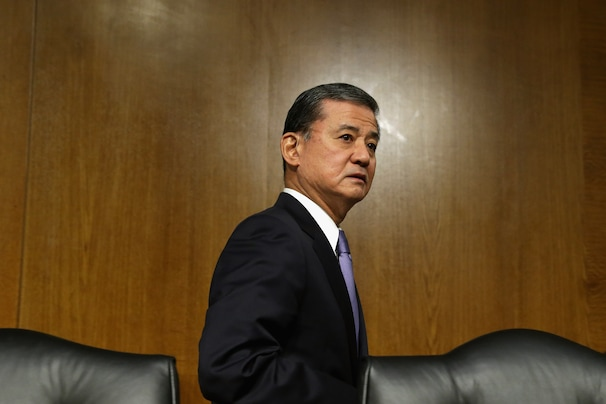 WASHINGTON, DC - MAY 15:  U.S. Veterans Affairs Secretary Eric Shinseki reenters the hearing room after testifying to the Senate Veterans' Affairs Committee about wait times veterans face  to get medical care May 15, 2014 in Washington, DC. The American Legion called Monday for the resignation of Shinseki amid reports by former and current VA employees that up to 40 patients may have died because of delayed treatment at an agency hospital in Phoenix, Arizona.  (Photo by Chip Somodevilla/Getty Images)