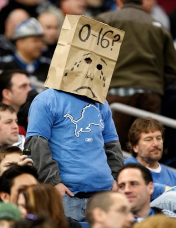 A fan wears a paper bag on his head during the Detroit Lions-New Orleans Saints NFL football game in Detroit, Sunday, Dec. 21, 2008. New Orleans won 42-7 to drop Detroit to 0-15. (AP Photo/Paul Sancya)
