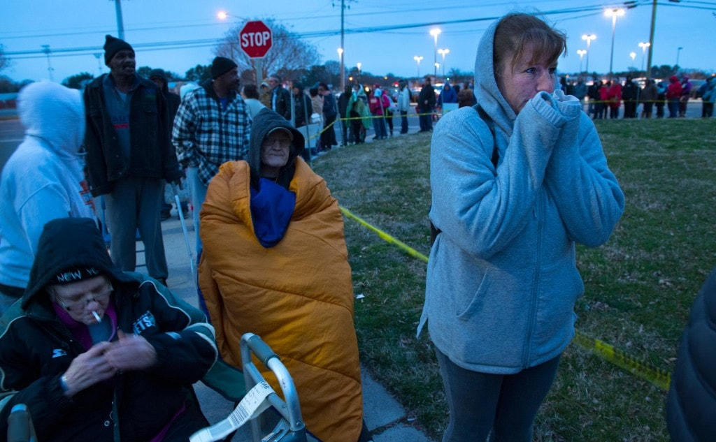 SALISBURY, MD - MARCH 10:   In sub-freezing temperatures, Dee Matello (R) age 46 waits in line with hundreds of others for a shot at free dental care from the Eastern Shore Mission of Mercy dental clinic in Salisbury, MD on March 10, 2017.   Her family survives on money from this business run but they have no dental coverage.  She hasn't seen a dentist in about eight years after her husband lost his job that provided dental benefits.  Since then, the couple has put their children's dental needs first and say there hasn't been enough money for their own.  Matello was among hundreds of people who waited in below-freezing temperatures for hours this morning to attend a free dental clinic in Salisbury, MD.  Her tooth gets pulled tomorrow.  The line for the Eastern Shore Mission of Mercy clinic began at 4p the night before.    Many patients at the free clinic are unemployed, retired, undocumented however, some are full-time workers whose employers do not offter dental coverage.  However, like Matello, there is class of workers who live above the defined poverty level but do not make enough to afford dental care for themselves or their familiy.  (Photo by Linda Davidson / The Washington Post)