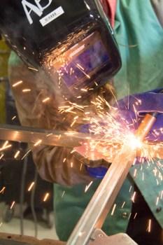 A.D. Quinn welding a piece