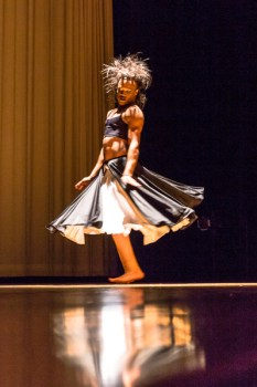 male dancer in skirt dancing on stage