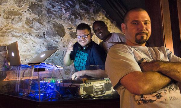 DJ booth with three men