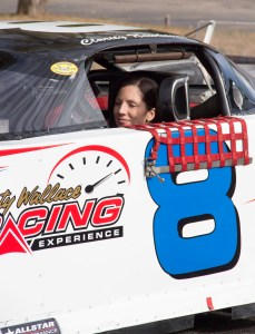 Clarity Newhouse drives her race car