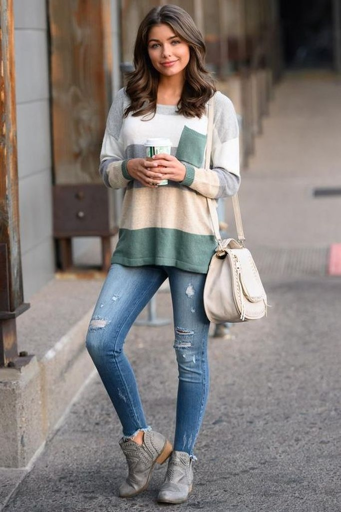 Spring outfit with combination sweater and jeans and booties