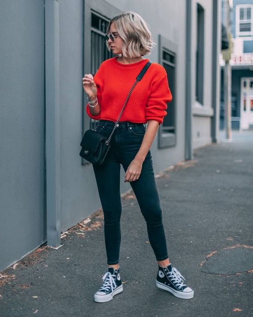 Spring outfit with combination bright red sweater and black jeans