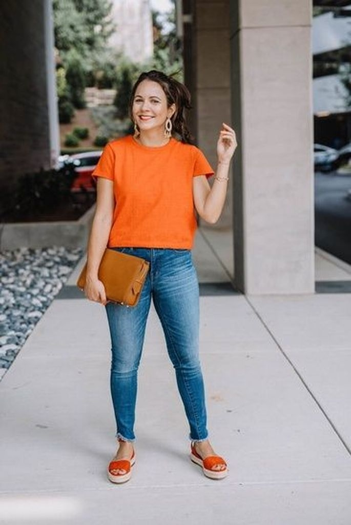 Spring outfit with orange t-shirt and jeans