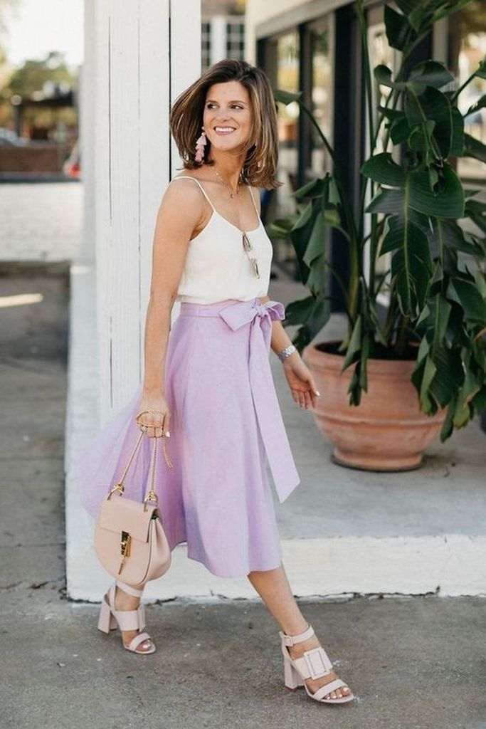 Spring outfit with white top and purple skirt