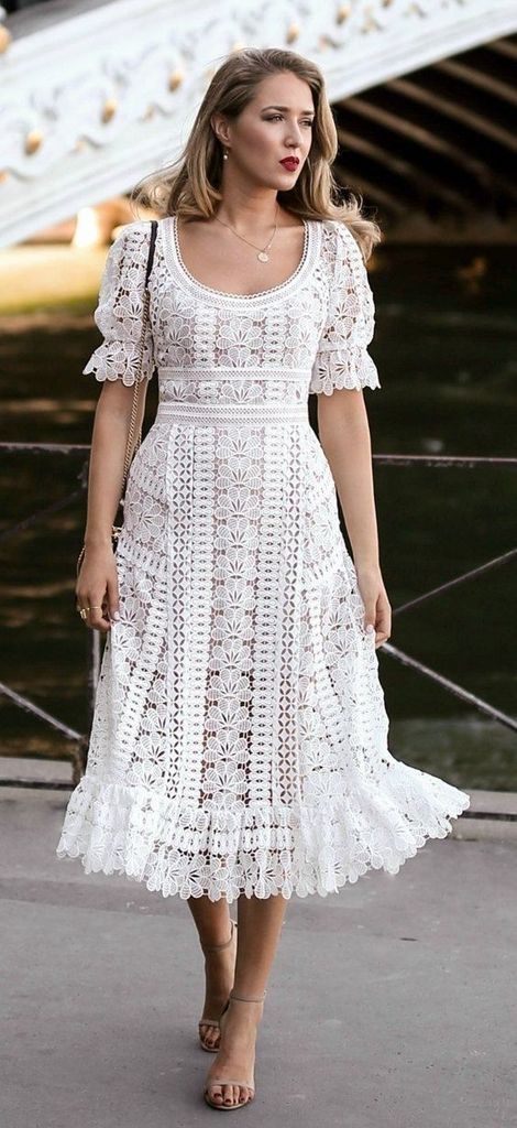 Embroidered dress with white color