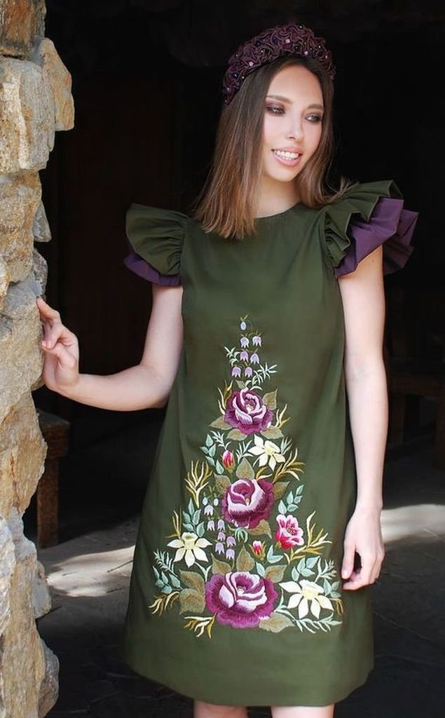 Green short dress with embroidered sunflowers design