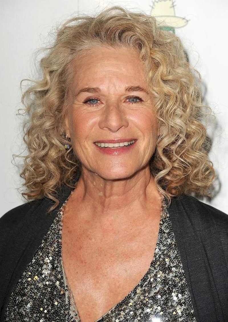 Women over 50 with curly hairstyle